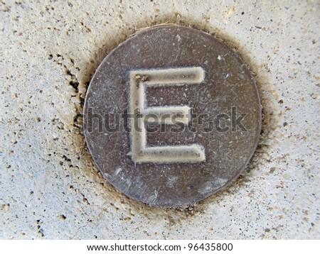 Pressed Metal Letter E - stock photo