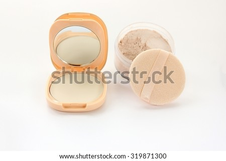 Pressed powders and powder puff on white background. - stock photo