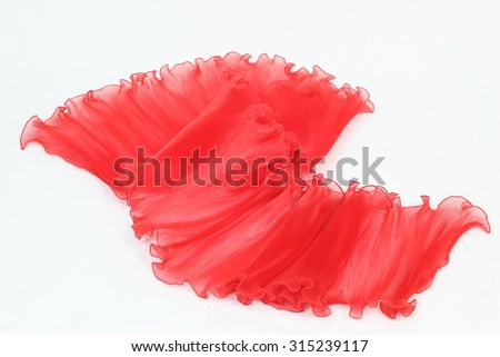 Pressing a red chiffon on a white background.