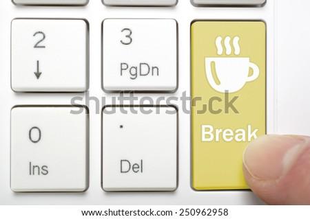 Pressing break and coffee key on keyboard - stock photo
