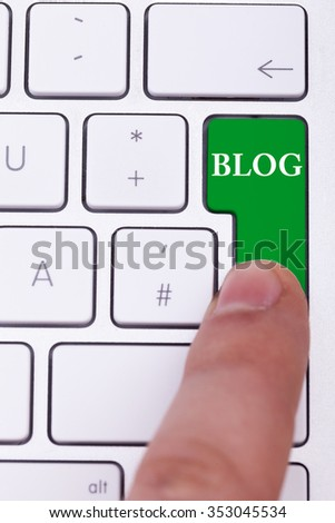 Pressing the blog button on keyboard. Blogging and writing online - stock photo