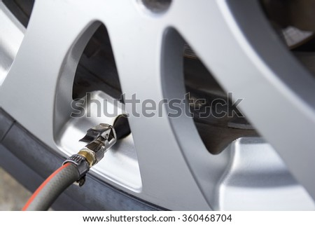 Pressure check and inflating car tire