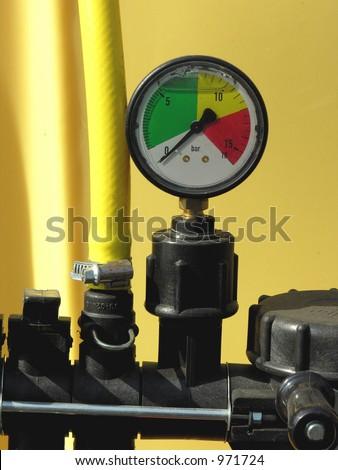 Pressure gauge and valve - stock photo