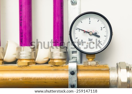 pressure gauge indicator in boiler-room - stock photo