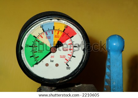 Pressure gauge manometer and valve on indusrial vehicle - stock photo