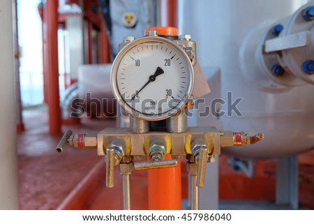 Pressure gauge, measuring instrument close up on oil and gas pipeline.