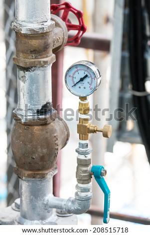 Pressure guage and Valve in Factory  - stock photo