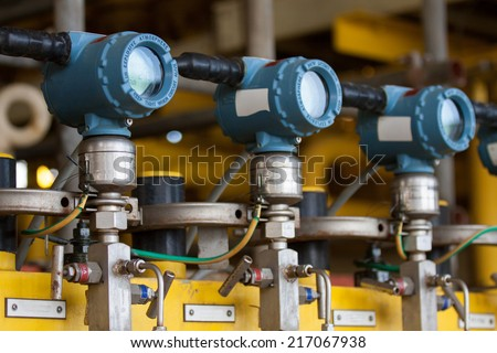 Pressure transmitter in oil and gas process , send signal to controller and reading pressure in the system. - stock photo