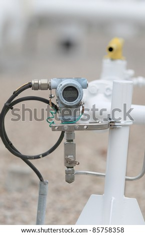 pressure transmitter measure live reading from main line pipe. - stock photo