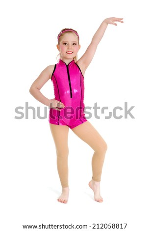 Preteen Acro Jazz Dancer Poses in Pink Recital Costume on White Background