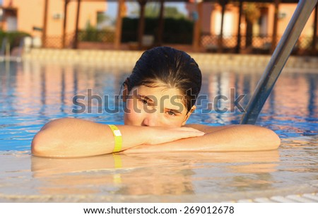 preteen beautiful girl  in open air swimming pool at the egyptian sea resort hotel - stock photo
