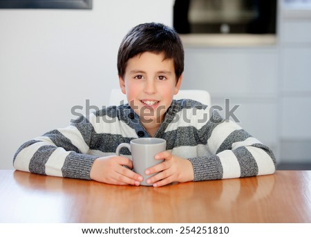 Preteen boy breakfast on the stairs at home - stock photo