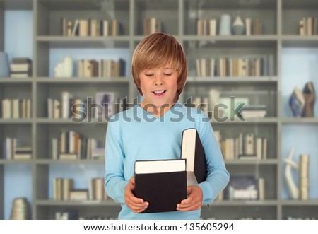 Preteen boy with books for reading in the library - stock photo