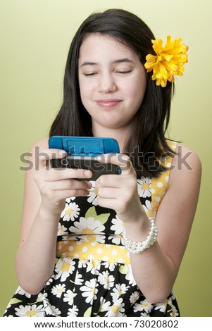 Preteen girl texting on cell phone