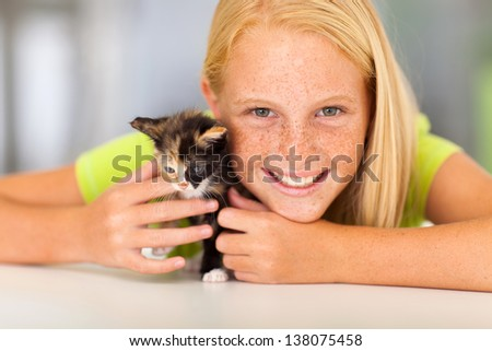 preteen girl with her pet friend closeup portrait - stock photo
