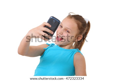 preteen girl with mobile phone taking a self-portrait