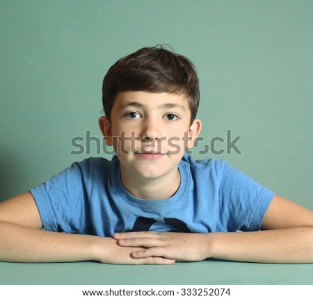 preteen handsome boy close up portrait isolated on blue - stock photo