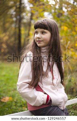 preteen pretty girl on the autumn background