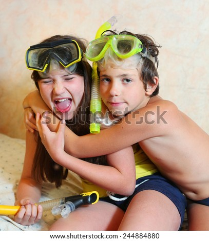 preteen siblings boy and girl in snorkeling mask and tube - stock photo