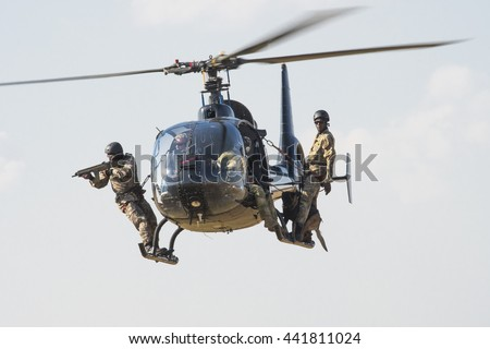 PRETORIA, SOUTH AFRICA-JUNE 11 2016: A helicopter with armed handlers and dogs demonstrate the Paramount K9 anti-rhino poaching team at the  Airlink Adrenaline Airshow at Wonderboom Airport.