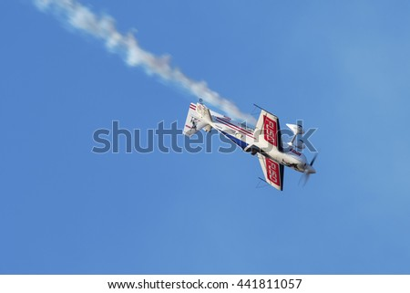 PRETORIA, SOUTH AFRICA-JUNE 11 2016: Neville Ferreira in an inverted dive at the Airlink Adrenaline Airshow at Wonderboom Airport.