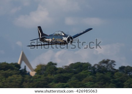 PRETORIA, SOUTH AFRICA-MAY 7 2016: A North American T-28 Trojan flying past the Bayes Hill memorial during the Swartkops Museum Airshow