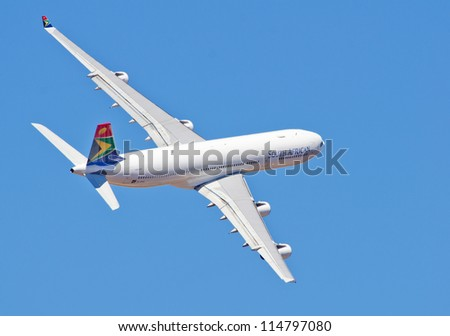PRETORIA, SOUTH AFRICA -SEPT. 23:  A SAA Airbus 340 low level flypast at the African Aerospace & Defence show on Sept. 23, 2012 at AFB Waterkloof in Pretoria. - stock photo