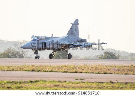 PRETORIA, SOUTH AFRICA-SEPTEMBER 17 2016: A Gripen fighter landing  with canards in breaking position at  the African Air Defense show at AFB Waterkloof
