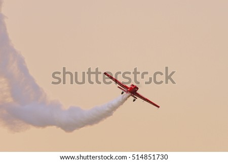PRETORIA, SOUTH AFRICA-SEPTEMBER 17 2016: Nigel Hopkins trailing smoke in his Extra aerobatic aricraft at the African Air Defense show at AFB Waterkloof