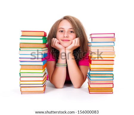 Pretty adolescent girl between bunch of colorful books smiling kindly
