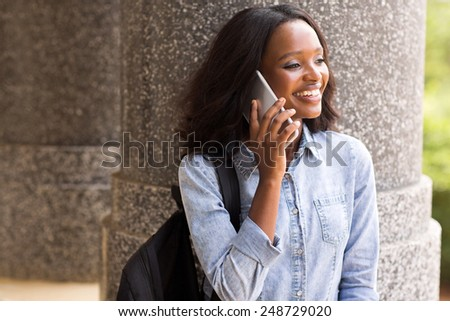 pretty african american college student making a phone call - stock photo