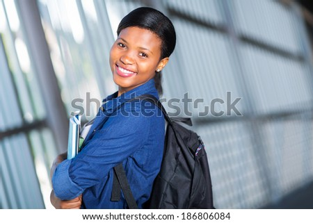 pretty african american college student posing on campus