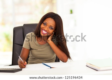pretty african american college student studying - stock photo
