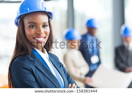 pretty african american female construction worker in office - stock photo