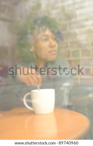 Pretty African American girl with espresso cup