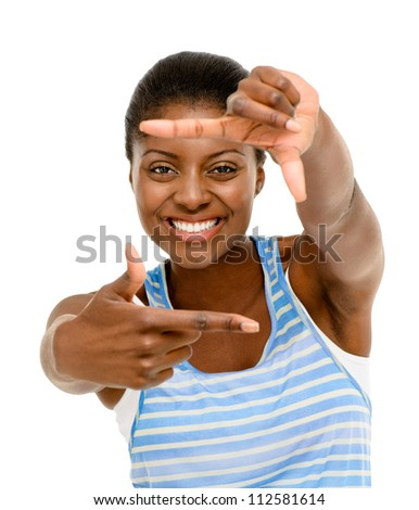 Pretty African American woman framing photograph using hand isolated on white background