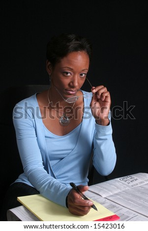 Pretty african american woman making financial decisions - stock photo