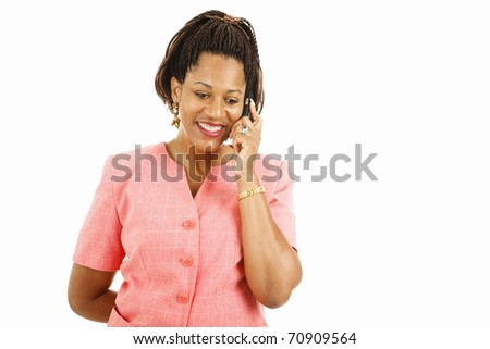 Pretty african-american woman talking on her mobile phone.  Isolated on white.