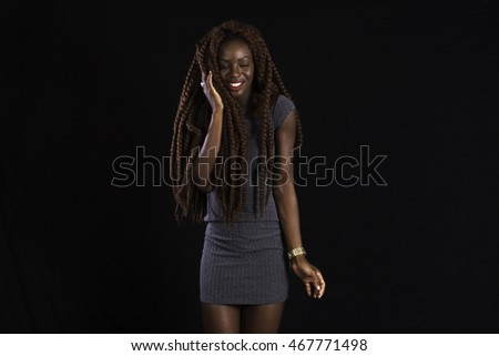 Pretty African American woman with long dreadlocks, with hand to her face in sadness or pain