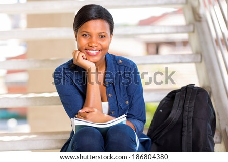 pretty african college girl portrait on campus - stock photo