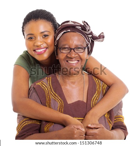 pretty african daughter hugging her senior mother over white background - stock photo