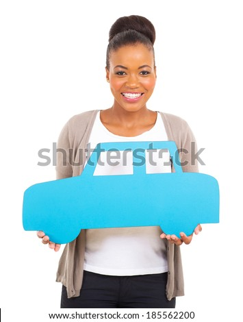 pretty african woman holding a car symbol isolated on white - stock photo
