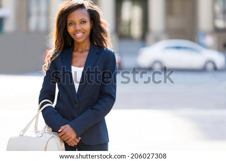 pretty african woman standing in the urban street - stock photo