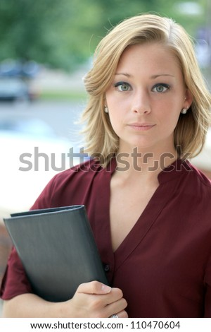 Pretty and Attractive Young Professional Young Business Woman That is Looking at the Camera Seriously - stock photo