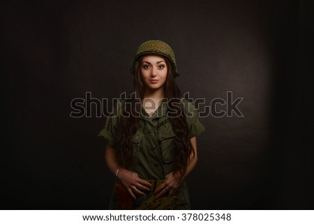 pretty army girl with rifle isolated on black - stock photo