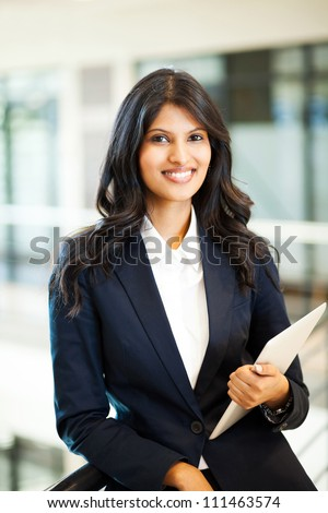 pretty asian businesswoman with tablet computer - stock photo