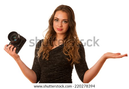 Pretty asian caucasian woman with camera in her hands smiling isolated over white background - stock photo