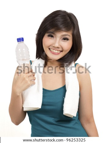 pretty asian girl holding a bottle of drink after exercise - stock photo