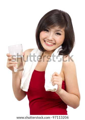 pretty asian girl holding a glass of water after exercise - stock photo