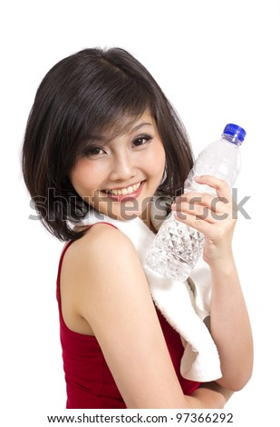 pretty asian girl holding bottle after exercise
